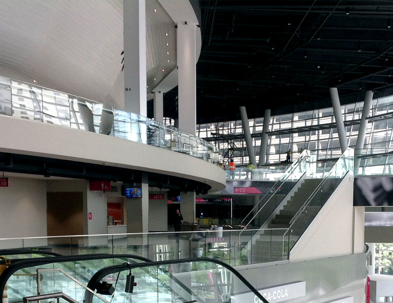 Glass Base Shoe railing on concourse stairs and balcony overlooks
