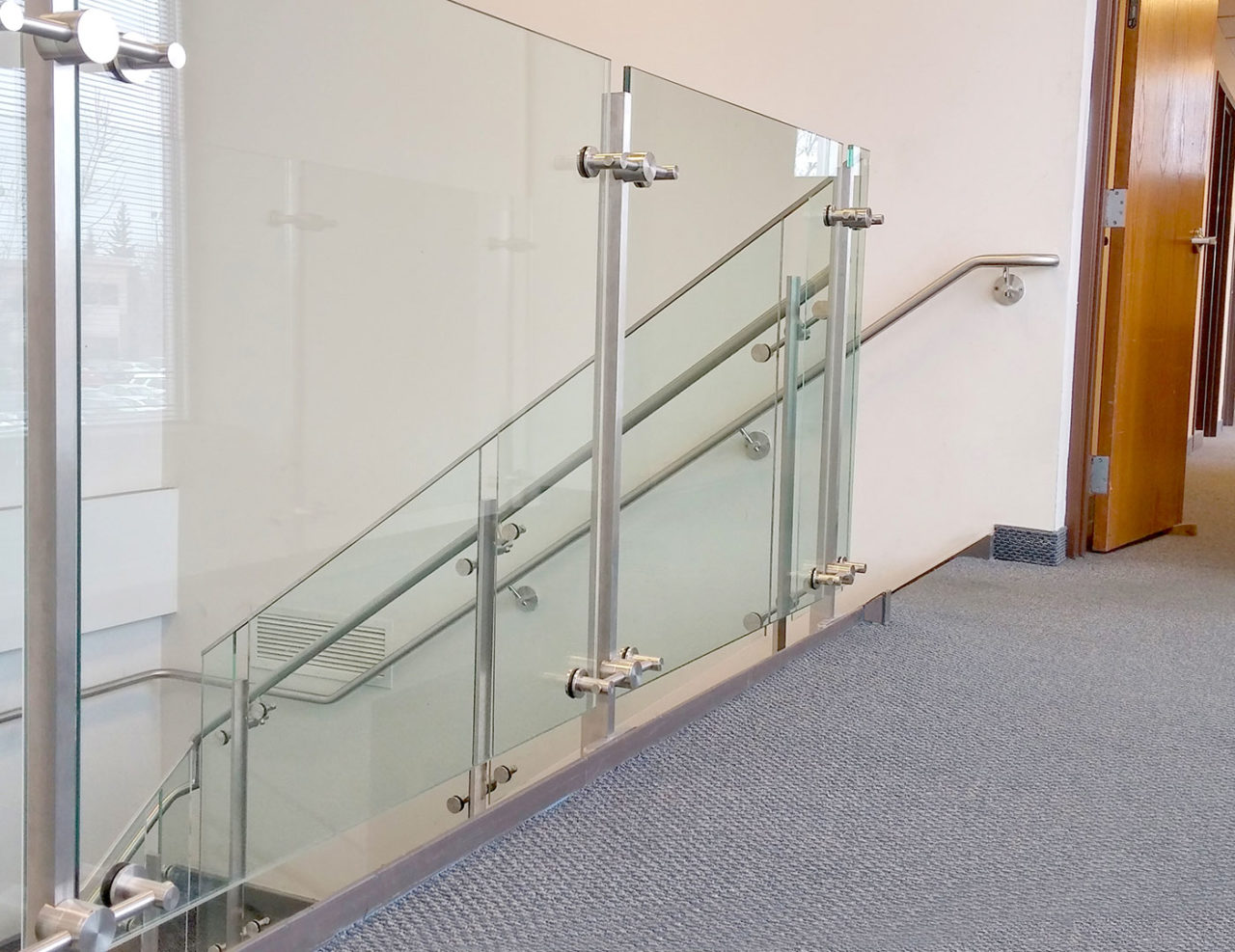 Glass railing with rod style mounts sc company