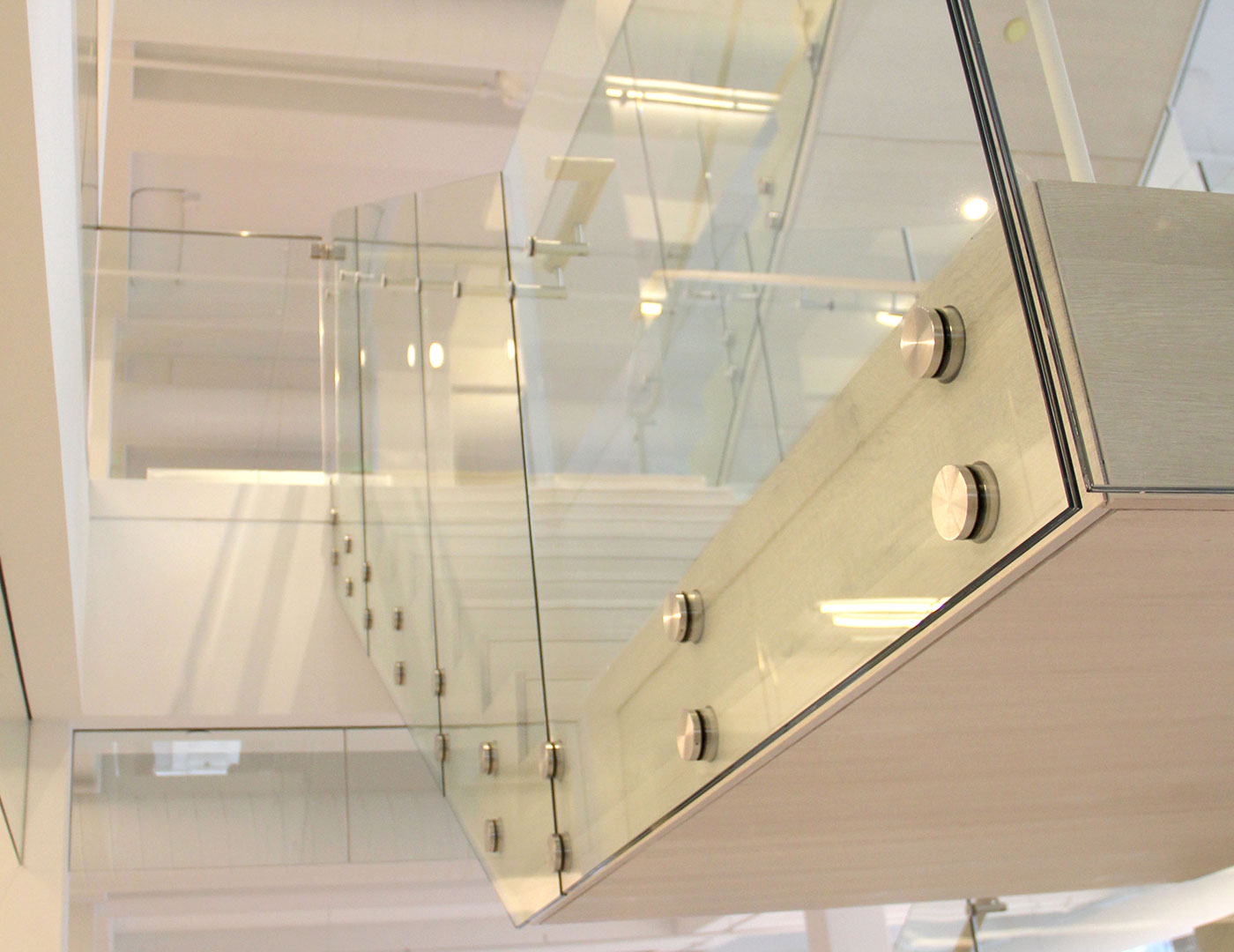 Glass railing featuring fascia mounted nodes sc