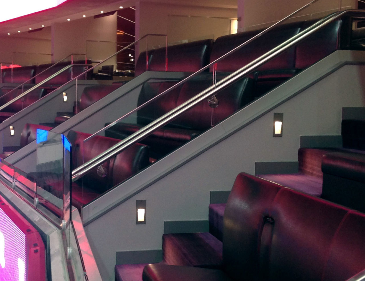 Glass railing at front of suites for clean sightlines